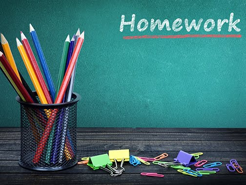 Homework text on green board and group of pencils